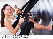 Купить «Girls practicing wall yoga with straps in studio», фото № 30737227, снято 29 января 2018 г. (c) Яков Филимонов / Фотобанк Лори