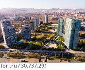 Купить «Aerial view of Diagonal Mar i el Front Maritim del Poblenou, Barcelona», фото № 30737291, снято 5 марта 2019 г. (c) Яков Филимонов / Фотобанк Лори