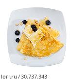 Купить «Top view of crepes with brie and honey», фото № 30737343, снято 9 июля 2020 г. (c) Яков Филимонов / Фотобанк Лори