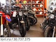 Купить «View of new motorcycles parked in showroom», фото № 30737375, снято 16 января 2019 г. (c) Яков Филимонов / Фотобанк Лори