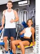 Купить «man taking break during workout in gym indoors», фото № 30738851, снято 4 октября 2016 г. (c) Яков Филимонов / Фотобанк Лори