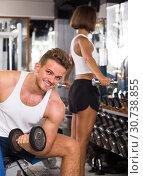 Купить «well trained man training hands using heavy weight dumbbells in gym indoors», фото № 30738855, снято 4 октября 2016 г. (c) Яков Филимонов / Фотобанк Лори