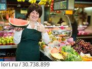Купить «Middle aged woman selling watermelon», фото № 30738899, снято 10 марта 2017 г. (c) Яков Филимонов / Фотобанк Лори