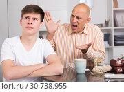 Купить «Man scolding son at home», фото № 30738955, снято 7 апреля 2019 г. (c) Яков Филимонов / Фотобанк Лори