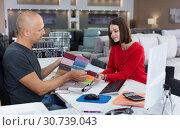 Купить «Consultant helping woman choosing upholstery fabric», фото № 30739043, снято 29 октября 2018 г. (c) Яков Филимонов / Фотобанк Лори