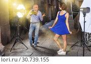 Купить «Photographer shooting female model on city street», фото № 30739155, снято 5 октября 2018 г. (c) Яков Филимонов / Фотобанк Лори
