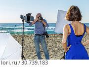 Купить «Professional photo shooting outdoors», фото № 30739183, снято 5 октября 2018 г. (c) Яков Филимонов / Фотобанк Лори