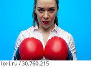 Купить «Ready for a fight. Determined business woman wearing boxing gloves.», фото № 30760215, снято 12 марта 2019 г. (c) Pavel Biryukov / Фотобанк Лори