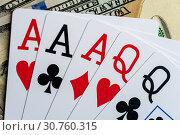 Купить «Playing Cards and Stack of 100 American Dollars Bills.», фото № 30760315, снято 16 июля 2020 г. (c) Pavel Biryukov / Фотобанк Лори