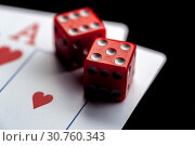 Купить «Close-up - Two aces, playing cards and red gaming dices on black table.», фото № 30760343, снято 20 мая 2019 г. (c) Pavel Biryukov / Фотобанк Лори