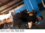 Купить «Sportive Friends Doing Exercises for Strong Back Muscles.», фото № 30760435, снято 3 февраля 2019 г. (c) Pavel Biryukov / Фотобанк Лори