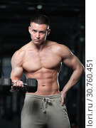 Купить «Shirtless Fitness Model Showing Well Trained Physique», фото № 30760451, снято 3 февраля 2019 г. (c) Pavel Biryukov / Фотобанк Лори
