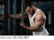 Купить «Muscular Handsome Man Posing in Gym.», фото № 30760487, снято 3 февраля 2019 г. (c) Pavel Biryukov / Фотобанк Лори