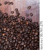 Купить «Coffee beans on dark wooden background», фото № 30761275, снято 18 июля 2019 г. (c) Яков Филимонов / Фотобанк Лори