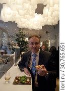 Купить «UK SCOTLAND Edinburgh -- 25 Nov 2010 -- The Scottish Government Rural Affairs Secretary Richard Lochhead enjoys a salmon h'orderves and a Scotch whisky...», фото № 30765651, снято 25 ноября 2010 г. (c) age Fotostock / Фотобанк Лори