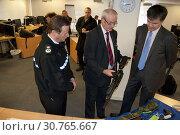Купить «UK SCOTLAND Edinburgh -- 29 Nov 2010 -- Scottish Secretary Michael Moore (right) talks with Sgt Douglas Roy (centre) and Chief Constable David Strang ...», фото № 30765667, снято 29 ноября 2010 г. (c) age Fotostock / Фотобанк Лори
