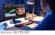 Купить «editor working on video file on computer at night», видеоролик № 30770307, снято 19 августа 2019 г. (c) Syda Productions / Фотобанк Лори