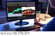 Купить «editor working on video file on computer at night», видеоролик № 30770311, снято 19 августа 2019 г. (c) Syda Productions / Фотобанк Лори