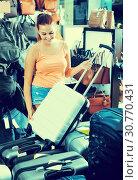 Купить «glad teenager girl choosing new large plastic luggage bag», фото № 30770431, снято 15 сентября 2016 г. (c) Яков Филимонов / Фотобанк Лори