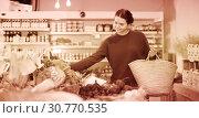 Купить «smiling young girl buying cauliflower at market», фото № 30770535, снято 1 марта 2017 г. (c) Яков Филимонов / Фотобанк Лори