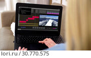 Купить «woman with video editor program on laptop at home», видеоролик № 30770575, снято 22 мая 2019 г. (c) Syda Productions / Фотобанк Лори