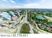 Купить «Aerial city view with crossroads and roads, houses, buildings, parks and parking lots. Sunny summer panoramic image», фото № 30778651, снято 21 января 2020 г. (c) Александр Маркин / Фотобанк Лори