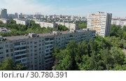 Купить «Top view of the district Severnoye Tushino in Moscow, Russia.», видеоролик № 30780391, снято 23 мая 2019 г. (c) Володина Ольга / Фотобанк Лори