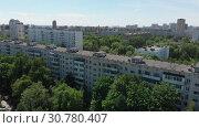 Купить «Top view of the district Severnoye Tushino in Moscow, Russia.», видеоролик № 30780407, снято 23 мая 2019 г. (c) Володина Ольга / Фотобанк Лори