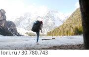 Купить «Young woman walking on a lago di braies coast with a big backpack», видеоролик № 30780743, снято 20 мая 2019 г. (c) Константин Шишкин / Фотобанк Лори