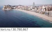 Купить «Aerial view of sand beach and city Benidorm, Spain», видеоролик № 30780867, снято 17 апреля 2019 г. (c) Яков Филимонов / Фотобанк Лори