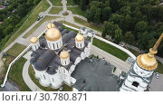 Купить «Aerial view of Assumption Cathedral in Vladimir - outstanding monument of white-stone architecture of Medieval Russia», видеоролик № 30780871, снято 28 июня 2018 г. (c) Яков Филимонов / Фотобанк Лори