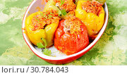 Купить «Red and yellow bell stuffed peppers with rice and minced meat», фото № 30784043, снято 29 июля 2018 г. (c) easy Fotostock / Фотобанк Лори