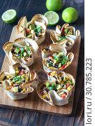 Купить «Tortilla burrito bowls stuffed with rice and vegetables», фото № 30785223, снято 7 октября 2018 г. (c) easy Fotostock / Фотобанк Лори