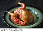 Baked quail wrapped in bacon on the plate. Стоковое фото, фотограф YAY Micro / easy Fotostock / Фотобанк Лори