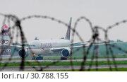 Купить «Cargo airplane taxiing after landing», видеоролик № 30788155, снято 4 мая 2019 г. (c) Игорь Жоров / Фотобанк Лори