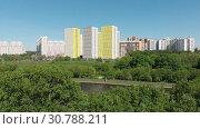 Купить «The Cityscape of Levoberezhnyy district in Khimki city. Russia», видеоролик № 30788211, снято 22 мая 2019 г. (c) Володина Ольга / Фотобанк Лори