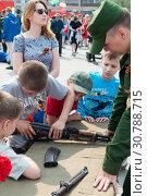 Купить «Tyumen, Russia, on May 9, 2019: The Russian children are interested in types of firearms», фото № 30788715, снято 9 мая 2019 г. (c) Землянникова Вероника / Фотобанк Лори