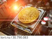 Купить «Bitcoin composition. Golden bitcoin among the electronic computer components, concept of bitcoin digital cryptocurrency», фото № 30790083, снято 4 апреля 2019 г. (c) Зезелина Марина / Фотобанк Лори