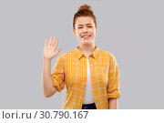 Купить «smiling red haired teenage girl waving hand», фото № 30790167, снято 28 февраля 2019 г. (c) Syda Productions / Фотобанк Лори