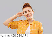 Купить «smiling red haired teenage girl showing peace», фото № 30790171, снято 28 февраля 2019 г. (c) Syda Productions / Фотобанк Лори
