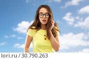 Купить «scared young woman or teenage girl in glasses», фото № 30790263, снято 29 января 2019 г. (c) Syda Productions / Фотобанк Лори