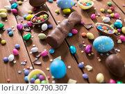 Купить «chocolate eggs, easter bunny and candies on wood», фото № 30790307, снято 22 марта 2018 г. (c) Syda Productions / Фотобанк Лори