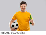 Купить «man or football fan with soccer ball and beer», фото № 30790383, снято 3 февраля 2019 г. (c) Syda Productions / Фотобанк Лори