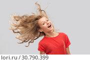 Купить «smiling teenage girl in red with long wavy hair», фото № 30790399, снято 17 февраля 2019 г. (c) Syda Productions / Фотобанк Лори