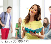 Купить «teenage student girl with notebook and pencil», фото № 30790471, снято 29 января 2019 г. (c) Syda Productions / Фотобанк Лори