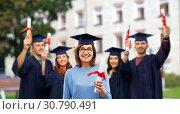 Купить «happy senior graduate student woman with diploma», фото № 30790491, снято 8 февраля 2019 г. (c) Syda Productions / Фотобанк Лори