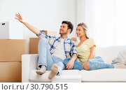 Купить «happy couple with cardboard boxes at new home», фото № 30790515, снято 25 февраля 2016 г. (c) Syda Productions / Фотобанк Лори