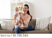 Купить «happy mother with little baby boy at home», фото № 30790543, снято 1 сентября 2017 г. (c) Syda Productions / Фотобанк Лори