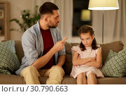 Купить «upset or feeling guilty girl and father at home», фото № 30790663, снято 4 ноября 2018 г. (c) Syda Productions / Фотобанк Лори