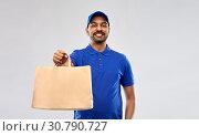 Купить «happy indian delivery man with food in paper bag», фото № 30790727, снято 12 января 2019 г. (c) Syda Productions / Фотобанк Лори